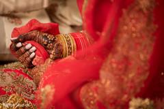 Maharani holding her veil at the wedding ceremony.