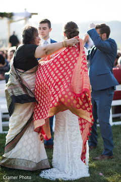 Beautiful capture of the Maharani being covered with the Antarpat