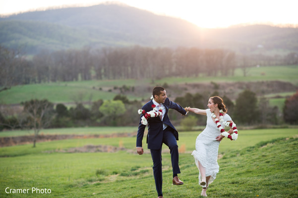 Indian newlyweds have fun outdoors after the ceremony.