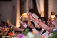 Gorgeous maharani makes a toast as the beautiful mehndi is shown.