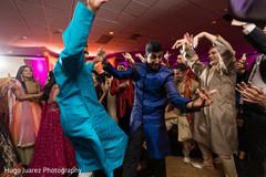 Indian dancing groom during sangeet