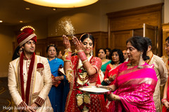 Indian bride throws rice behind her