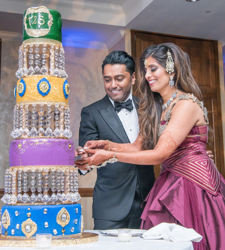 Indian wedding cutting the cake scene.