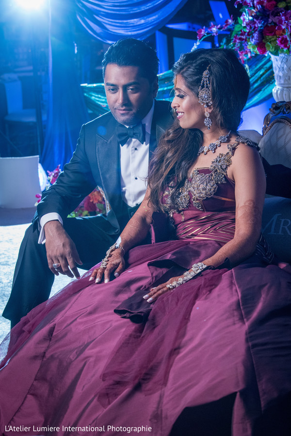 Sweet Indian couple enjoying their wedding reception.