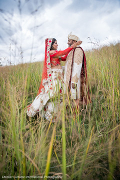 Gorgeous Indian bride  and groom in their ceremony traditional outfits.