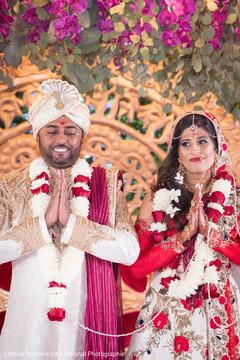 Joyful Indian couple at their wedding ceremony.