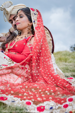 Dreamy Indian couple on their ceremony outfit outdoors portrait.
