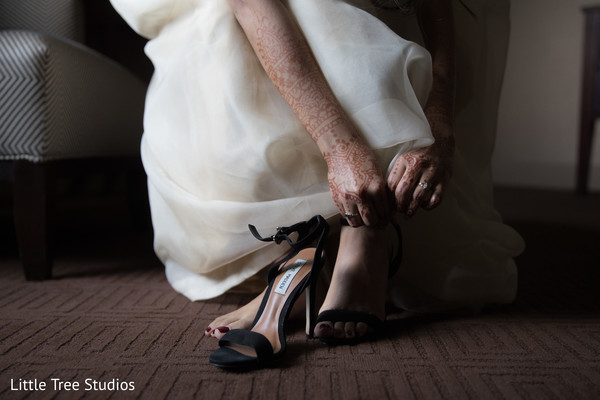 Indian bride changing her wedding shoes