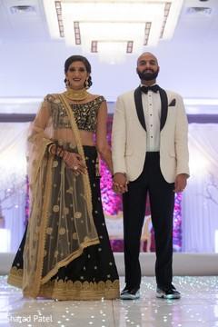 Elegant indian newlyweds at their wedding reception