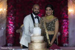 Indian couple about to cut their wedding cake