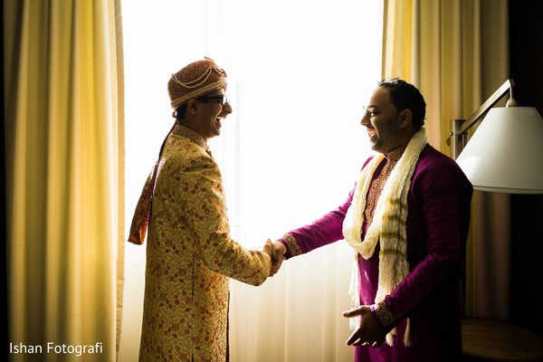Indian groom greeting a special guest prior to the the ceremony
