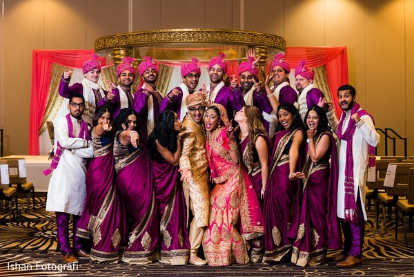Fun capture of Indian bridesmaids and groomsmen with the Indian couple