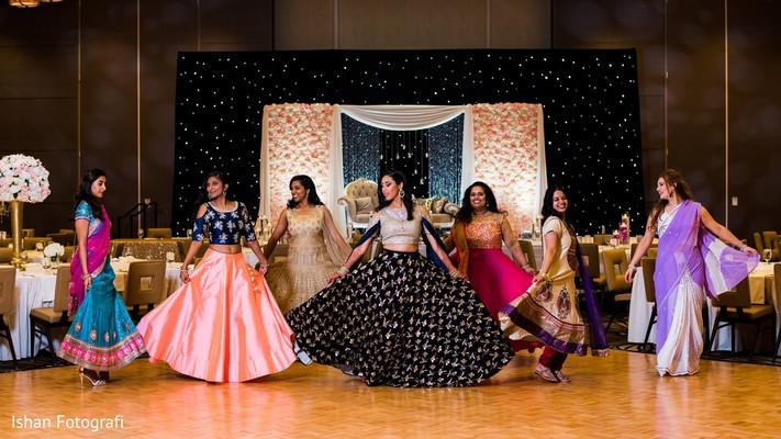 Beautiful Indian guests and maharani perform a choreography