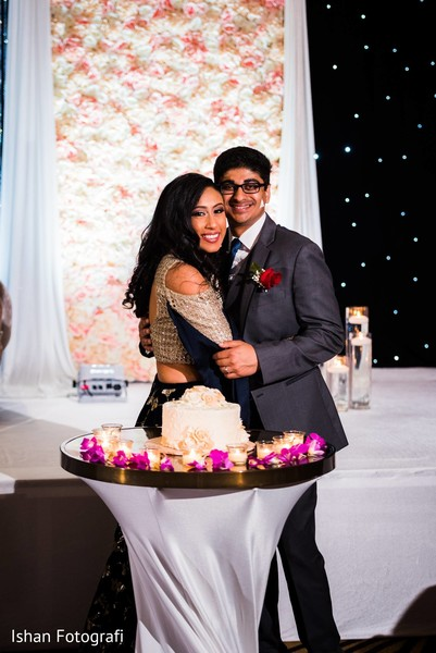 Enchanting capture of the Indian newlyweds and the cake