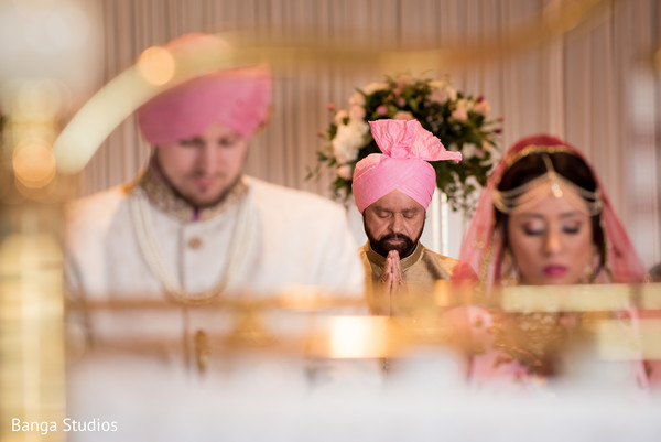 Sweet Indian couple at their wedding ceremony capture.