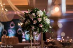 Unique Indian wedding reception table flowers centerpiece.