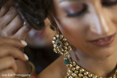 Detail of the beautiful earrings used by the Indian bride