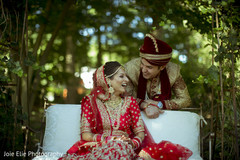 Indian bride and groom smile during the outdoor photo shoot