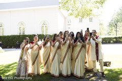 Beautiful Indian bridesmaids and family have fun with their phones.