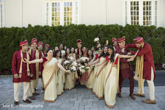 Beautiful capture of the Indian groomsmen and bridesmaids with the couple