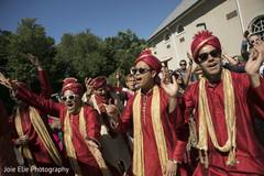 Groomsmen dance and enjoy the sun during the Baraat