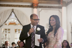 Maharani's parents deliver a speech at the Indian wedding reception