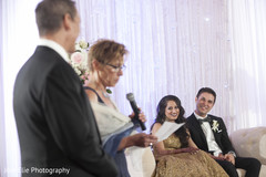 Groom's family delivers a speech at the Indian wedding reception