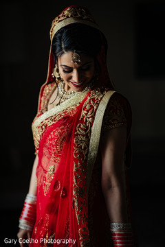 Stunning Indian bride posing with her wedding ceremony lengha.