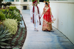 Lovely Indian  bride and groom holding hands.