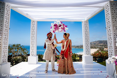 Ravishing Indian bride and grooms out doors capture.