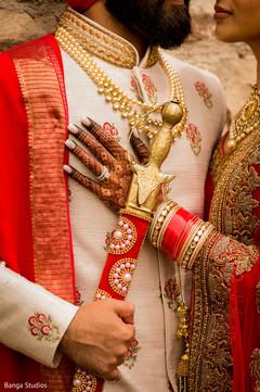 Ravishing Indian couple's wedding ceremony attire.