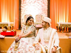 Indian newlyweds tenderly looking at each other at the venue