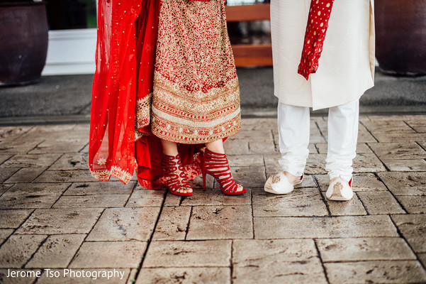 Indian bride and groom's shoes for wedding ceremony.
