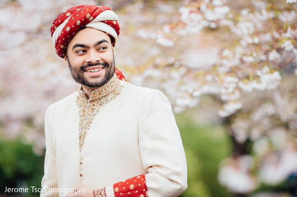 Elegant Indian groom posing for photo.