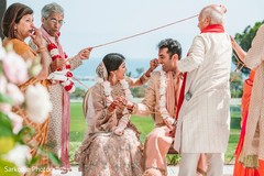Indian bride and groom getting the rope at wedding ceremony ritual.