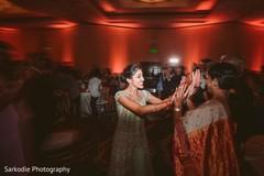 Joyful Indian bride at her wedding reception capture.