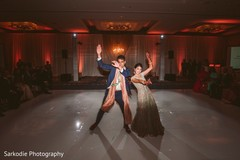 Lovely Indian couple enjoying their reception dance capture.