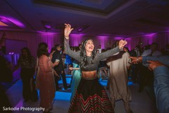 Upbeat Indian guests dance performance.