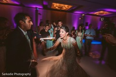 Lovely capture of Indian bride and groom at their reception dance.