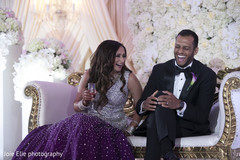 Lovely Indian newlyweds have a laugh during the reception