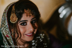 Beautiful Indian bride with her tikka and makeup done portrait.