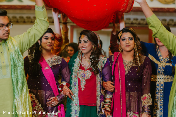 Indian bride and bridesmaids with their sangeet outfits.