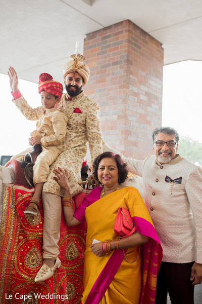 Indian groom posing with parents
