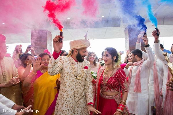 Indian wedding guests cheering the couple