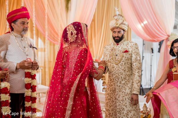 Indian groom welcoming the bride