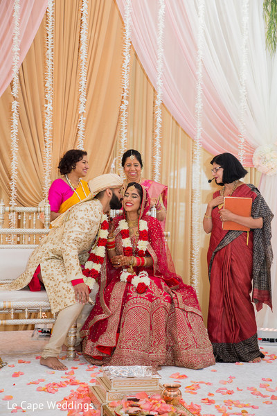 Sweet indian groom kissing the bride on the cheek