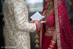 Indian groom reading bride's card