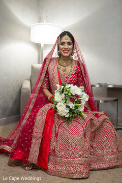 Gorgeous indian bride in a red and golden lengha
