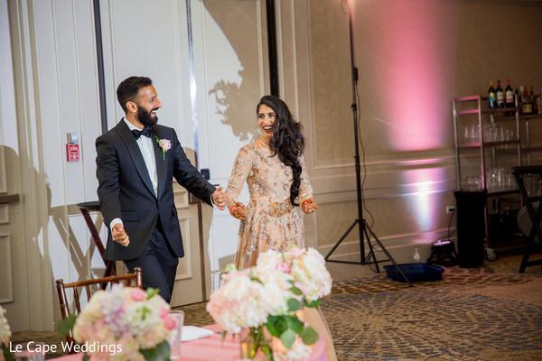 Indian lovebirds grand entrance to wedding reception
