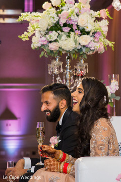 Indian newlyweds enjoy their drinks as the reception continues.